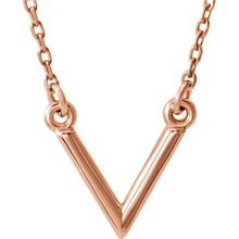 "Stunning design is found in this 14Kt rose gold ""V"" geometric pendant hanging from a 14Kt rose gold necklace 16.50"" inches in length. Total weight of the gold is 1.47 grams."