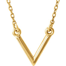 "Stunning design is found in this 14Kt yellow gold ""V"" geometric pendant hanging from a 14Kt yellow gold necklace 16.50"" inches in length. Total weight of the gold is 1.47 grams."