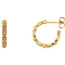 Superb style is found in these 14Kt yellow gold Granulated J-Hoop earrings accented with the brilliance of round full cut diamonds. Total weight of the diamonds is 1/6 carats.