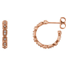 Superb style is found in these 14Kt rose gold Granulated J-Hoop earrings accented with the brilliance of round full cut diamonds. Total weight of the diamonds is 1/6 carats.