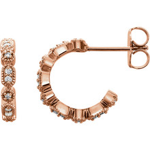Superb style is found in these 14Kt rose gold Granulated J-Hoop earrings accented with the brilliance of round full cut diamonds. Total weight of the diamonds is 1/8 carats.