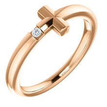 Featuring a round-cut diamond, this 14k rose gold sideways cross youth ring is a dazzling way to showcase your faith.
