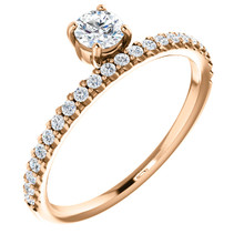 A classic beauty, this gorgeous 14k rose gold stackable ring showcases a sparkling row of shared-prong set diamonds.