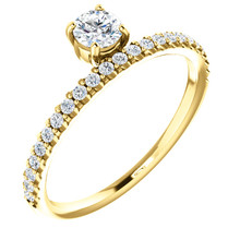 A classic beauty, this gorgeous 14k yellow gold stackable ring showcases a sparkling row of shared-prong set diamonds.