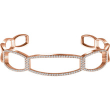 "Refined elegance is found in this 14Kt rose gold diamond cuff 6 1/4"" bracelet. Total weight of the diamonds is .75cts. Total weight of the gold is 12.10 grams."