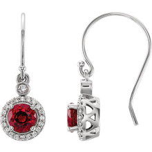 Wonderful 14Kt white gold halo-style earrings capturing the beauty of Chatham® created ruby surrounded by .08 carat total weight of white diamonds.