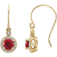 Wonderful 14Kt yellow gold halo-style earrings capturing the beauty of Chatham® created ruby surrounded by .08 carat total weight of white diamonds.