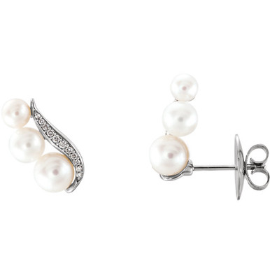Beautiful 14Kt white gold earrings featuring 6 pearls and 1/10 carats in white diamonds. Total weight of the gold is 1.88 grams.