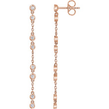 Stylish 14Kt Rose Gold Diamond Chain Earrings with friction backs. The length of the earring is 47mm. Total weight of the gold is 1.56 grams. Diamonds are H+ in color and I1 or better in clarity. These earrings makes an awesome Gift for that special someone in your life.