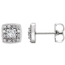 These exquisite diamond cluster stud earrings offer beauty equaled only to her own. Stunning in 14K white gold, these earrings feature 26 dazzling diamonds. Classic and elegant, these earrings captivate with 1/2 ct. t.w. of diamonds and a polished shine.