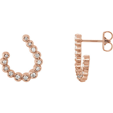 These 1/4 ct. t.w. diamond crescent drop earrings are set in 14K rose gold and secure with friction backs.