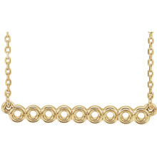 "Make a statement with this circle bar 16-18"" necklace. You will reach for this one over and over again. Diamond-cut cable chain with spring ring clasp closure. 14kt yellow gold necklace."