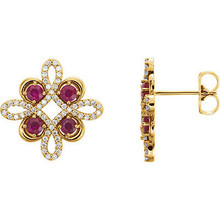 Beautiful 14k yellow gold clover earrings featuring eight gorgeous rubies and 1/4 total carat weight of diamonds.