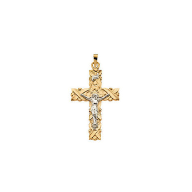 Comforting charm. This crucifix pendant features intricate design and beautiful 14k gold and 14k white gold. Chain sold separately!