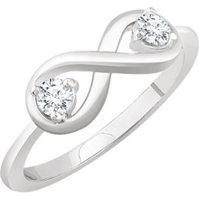 This 1/4 carat total weight diamond ring expresses the harmony of union with a two-stone diamond design in 14k white gold