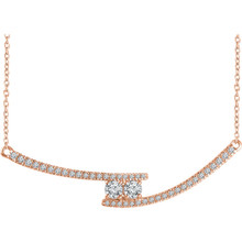 Chic and sparkling, this diamond two stone necklace features round diamonds in 14k rose gold, and a matching cable chain. This necklace can be worn at 16 or 18 inches in length.