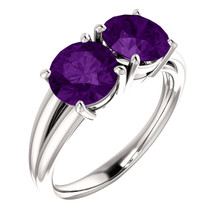 This feminine 14k white gold birthstone ring features two 7mm round shaped genuine amethyst gemstones.