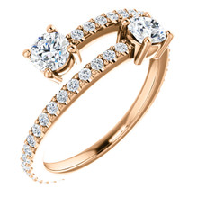 Diamond Two Stone Bypass Ring 7/8 CTW, G-H, I1 graded diamonds set in 14k rose gold. Features 2, 1/4 carat gemstones hand selected to match and set.