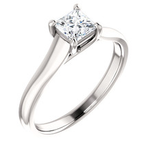 Simple, sleek and so stunning, take her breath away with this exquisite diamond engagement ring. Fashioned in cool 14k white gold, the eye is drawn to the 1/2 ct. round diamond center stone standing tall in a traditional four-prong setting.