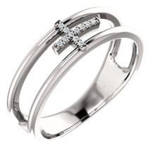 Exceptional 14Kt white gold diamond negative space cross design is captured in the ring. Total weight of the gold is 3.78 grams. Diamonds are G-H in color and I1 or better in clarity.