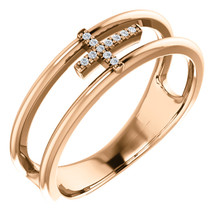 Exceptional 14Kt rose gold diamond negative space cross design is captured in the ring. Total weight of the gold is 3.91 grams. Diamonds are G-H in color and I1 or better in clarity.