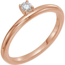 This lovely, diamond asymmetrical stackable ring is fashioned from high-polished 14K rose gold. Diamonds are G-H in color and I1 or better in clarity.