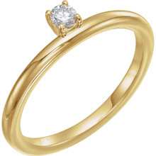 This lovely, diamond asymmetrical stackable ring is fashioned from high-polished 14K yellow gold. Diamonds are G-H in color and I1 or better in clarity.