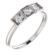 Celebrate a special occasion with this sparkling three-stone diamond ring. This lovely, 1/5 ct. tw. diamond three-stone stackable ring is fashioned from high-polished 14K white gold. Diamonds are G-H in color and I1 or better in clarity.