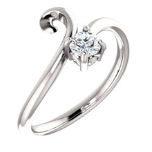 This 1/4 ct. diamond solitaire bypass ring is set in 14K white gold.