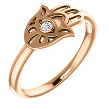 Ward off evil spirits - and be super stylish - with this diamond hamsa fashion ring in 14k rose gold.