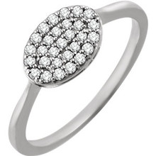 Chic, modern, playful, geometric, stunning, sharp, elegant, sophisticated and stylish... This diamond oval cluster ring really has a lot to say for itself. It contains 29 shimmering diamonds weighing 1/5 ct tw within a dazzling oval shape. It's design seems simple, but also evokes elegance. It is pictured here in 14kt white gold.