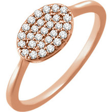 Chic, modern, playful, geometric, stunning, sharp, elegant, sophisticated and stylish... This diamond oval cluster ring really has a lot to say for itself. It contains 29 shimmering diamonds weighing 1/5 ct tw within a dazzling oval shape. It's design seems simple, but also evokes elegance. It is pictured here in 14kt rose gold.