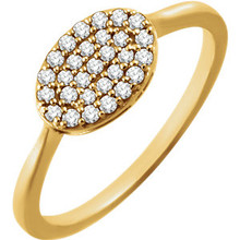 Chic, modern, playful, geometric, stunning, sharp, elegant, sophisticated and stylish... This diamond oval cluster ring really has a lot to say for itself. It contains 29 shimmering diamonds weighing 1/5 ct tw within a dazzling oval shape. It's design seems simple, but also evokes elegance. It is pictured here in 14kt yellow gold.