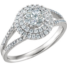 Sparkling and romantic, honor her on that special day with this exquisite diamond engagement ring. Expertly crafted in 1K white gold, this ring features a round cluster of shimmering round diamonds at its center. Designed to take her breath away, this ring delights with 5/8 ct. t.w. of diamonds and a polished shine.