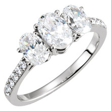A lifetime of romance is something to celebrate and treasure. honor the past, present and future of your love with a symbolic three stone engagement ring. Dazzling oval-cut diamonds brighten the heart of the ring-- each is prong-set for a look of sure brilliance. These magnificent diamonds total 1 9/10 ct. Slip this 14K white gold ring on her finger, and ask her to spend forever with you.