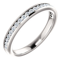 This eternity-style wedding band showcases round-cut white diamonds in channel setting. This jewelry is crafted of rich 14-karat white gold and shines with a high polish.