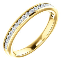 This eternity-style wedding band showcases round-cut white diamonds in channel setting. This jewelry is crafted of rich 14-karat yellow gold and shines with a high polish.