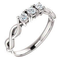 A lifetime of romance is something to celebrate and treasure. honor the past, present and future of your love with a symbolic three stone engagement ring. Dazzling round-cut diamonds brighten the heart of the ring-- each is prong-set for a look of sure brilliance. These magnificent diamonds total 1/4 ct. Slip this platinum ring on her finger, and ask her to spend forever with you.
