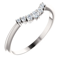 On your wedding day, speak your vows proudly as you slip this ring on her waiting finger. Fashioned in sleek 14K white gold, this band is set with a quartet of shimmering diamonds, all totaling 1/8 ct. Slightly contoured, this band was designed to fit snuggly beneath her solitaire. Polished to a brilliant shine, it's destined to become one of her most treasured pieces.