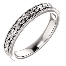 Exquisitely hand-engraved, this wedding ring features a beautiful design in 14k white gold.