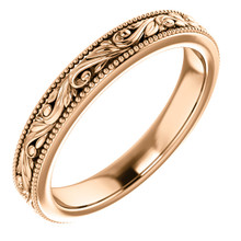 Exquisitely hand-engraved, this wedding ring features a beautiful design in 14k rose gold.