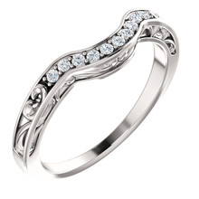 This beautiful diamond wedding band features sparkling 1/6 carat total weight round diamonds in a unique 14 karat white gold edged with a lovely vintage style that will make a great complement to her engagement ring on her very special wedding day.
