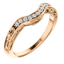 This beautiful diamond wedding band features sparkling 1/6 carat total weight round diamonds in a unique 14 karat rose gold edged with a lovely vintage style that will make a great complement to her engagement ring on her very special wedding day