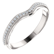This beautiful diamond wedding band features sparkling 1/8 carat total weight round diamonds in a unique 14 karat white gold edged with a lovely vintage style that will make a great complement to her engagement ring on her very special wedding day