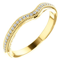 This beautiful diamond wedding band features sparkling 1/8 carat total weight round diamonds in a unique 14 karat yellow gold edged with a lovely vintage style that will make a great complement to her engagement ring on her very special wedding day