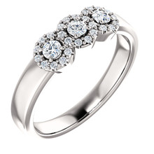 This elegant 14k white gold diamond engagement ring set is breathtakingly simple and modern. The engagement ring's featured three stone diamond halo design, is complemented with 29 sparkling white diamonds.