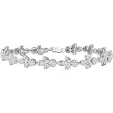 A classic look just for her, this diamond accented line bracelet is certain to take her breath away. Fashioned in cool 14K white gold, this timeless design features an awe-inspiring 1 3/4 cts. t.w. round diamonds, each with a color ranking of H+ and a clarity of I1. A sophisticated style, this 7.0-inch bracelet is polished to a brilliant shine.