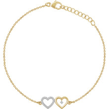 Wear your heart on your sleeve. .07 ct. t.w. diamonds glisten from this polished bracelet featuring two hearts.