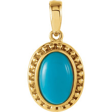 Delightful color is captured in this 11x7mm Genuine Turquoise in 14Kt yellow gold pendant featuring articulate design.