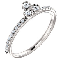 Celebrate a special occasion with this sparkling three-stone asymmetrical stackable diamond ring. This lovely, 1/5 ct. tw. diamond three-stone stackable ring is fashioned from high-polished platinum. Diamonds are G-H in color and I1 or better in clarity.